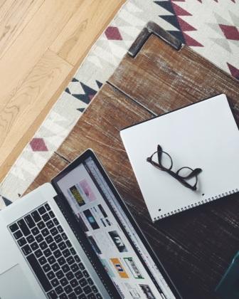 glasses-on-blank-journal-web